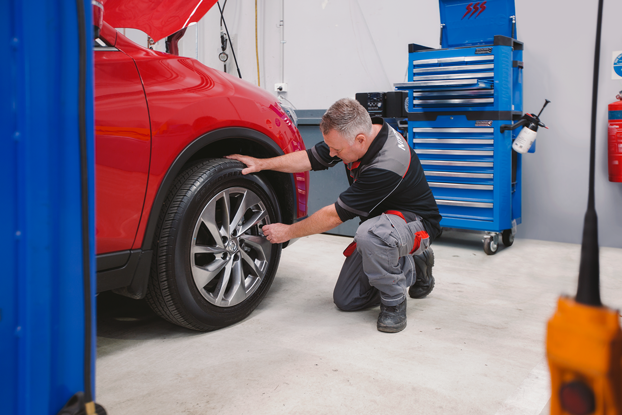 Nissan technician servicing tyres