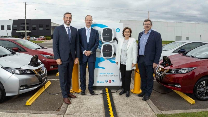 Stephen Lester, David Leal, Minister Lily D'Ambrosio, and Dr David Harris in front of Smart Solar EV Chargin Station
