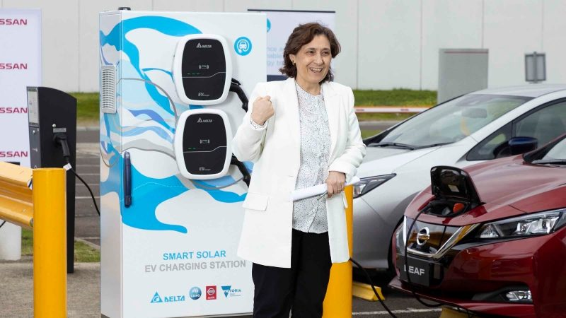 Minister Lily D'Ambrosio presenting in front of Smart Solar EV Charging Station