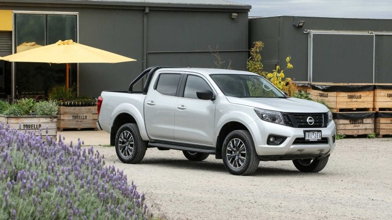 Navara at storefront with lavender bush