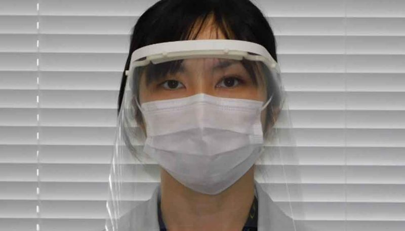 Nissan employee demonstrating face shield