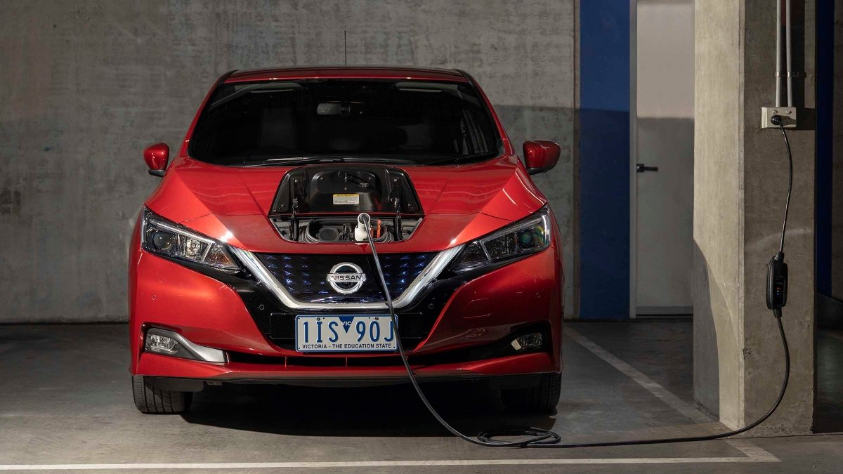 Nissan LEAF plugged into wall