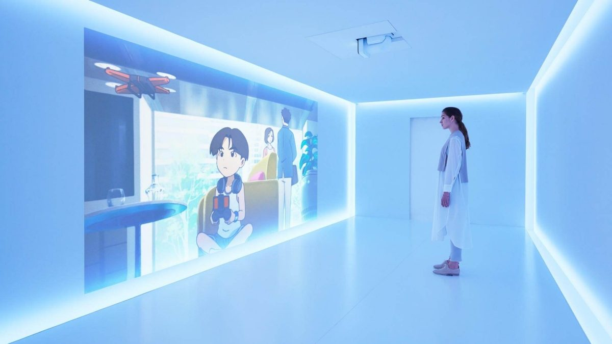 woman watching animation in Nissan pavilion