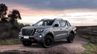 New Nissan Navara on remote ridge in front of distant sunset