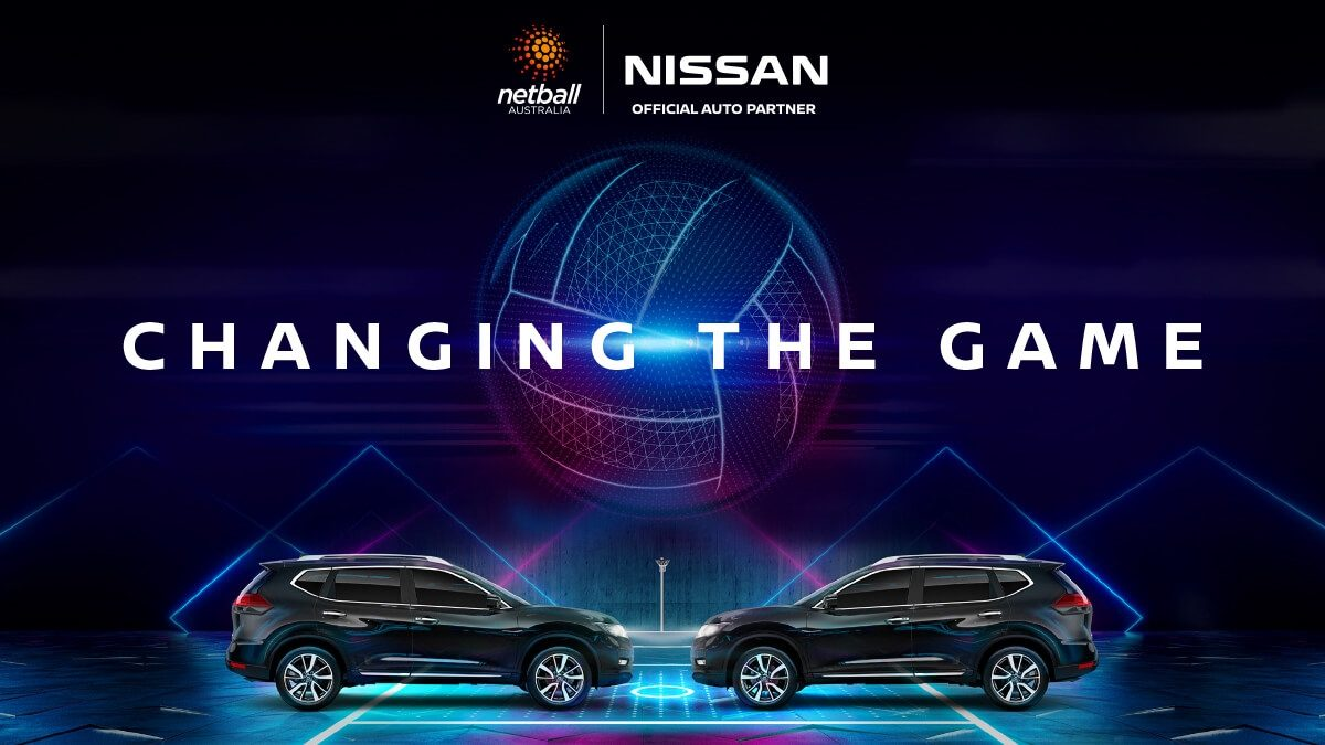 'Changing the game; Netball Australia, Nissan Official Auto Partner' - Stylised netball over two Nissan X-TRAIL's