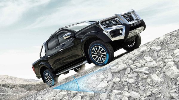 Navara with bullbar climbing gravel slope