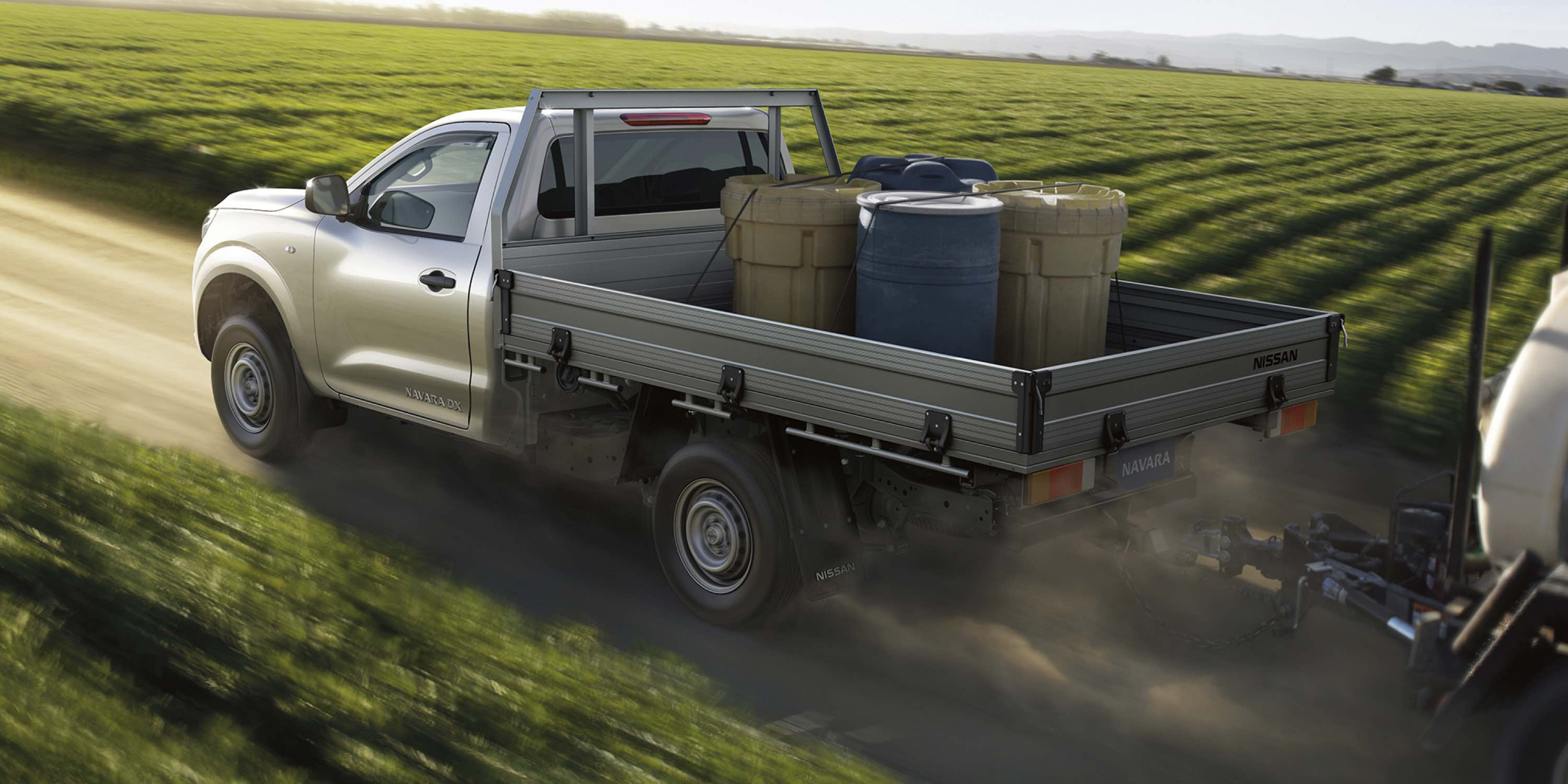 Nissan Navara towing farming equipment