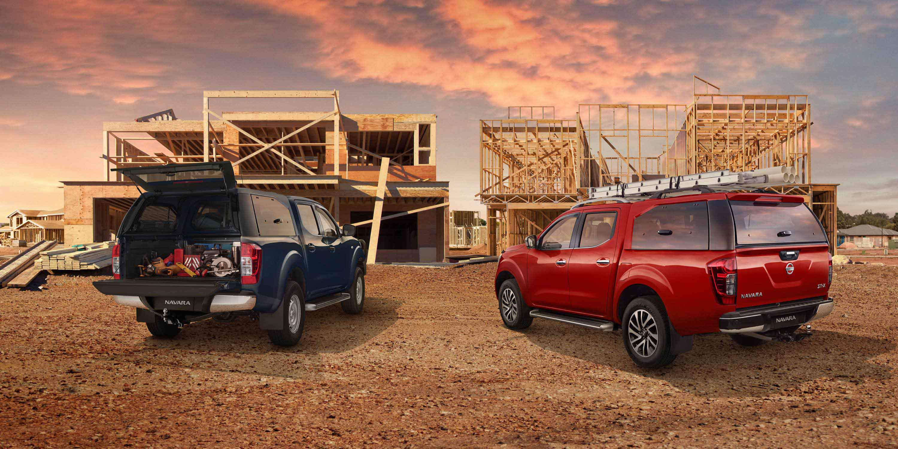 Two accessorised Nissan Navara's parked at construction site