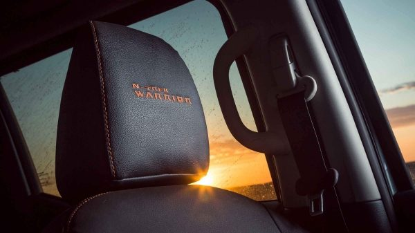 N-TREK Warrior headrest with orange fabric highlights
