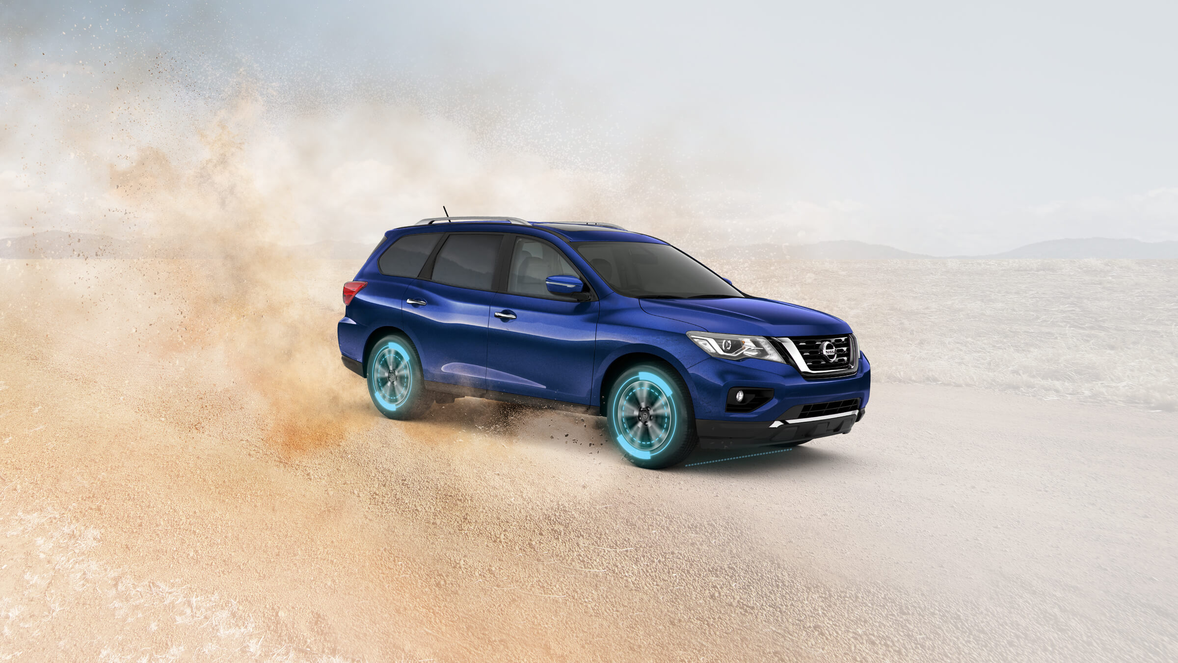Nissan Pathfinder driving across remote off-road terrain