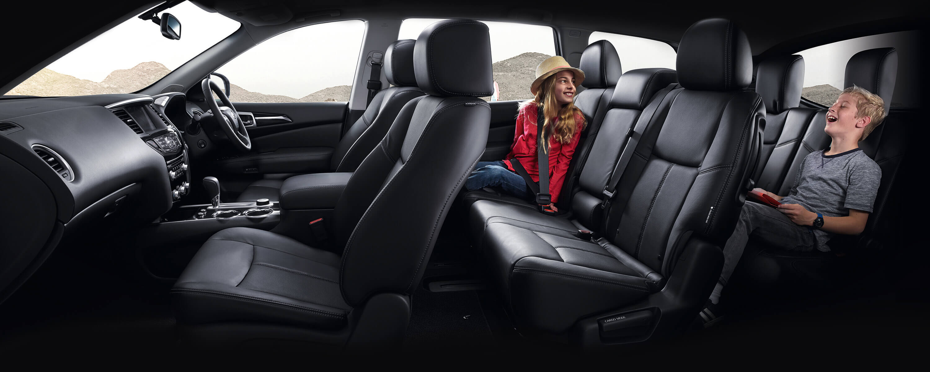 Children playing on the seats of Nissan Pathfinder