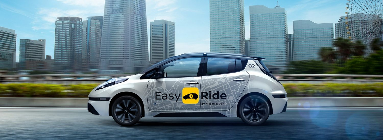 Nissan Easy Ride robo-taxi with city skyline