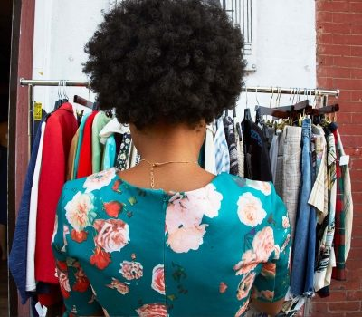 Woman shopping for vintage clothes