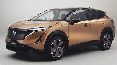 The 2021 Nissan ARIYA electric crossover production car in copper and black
