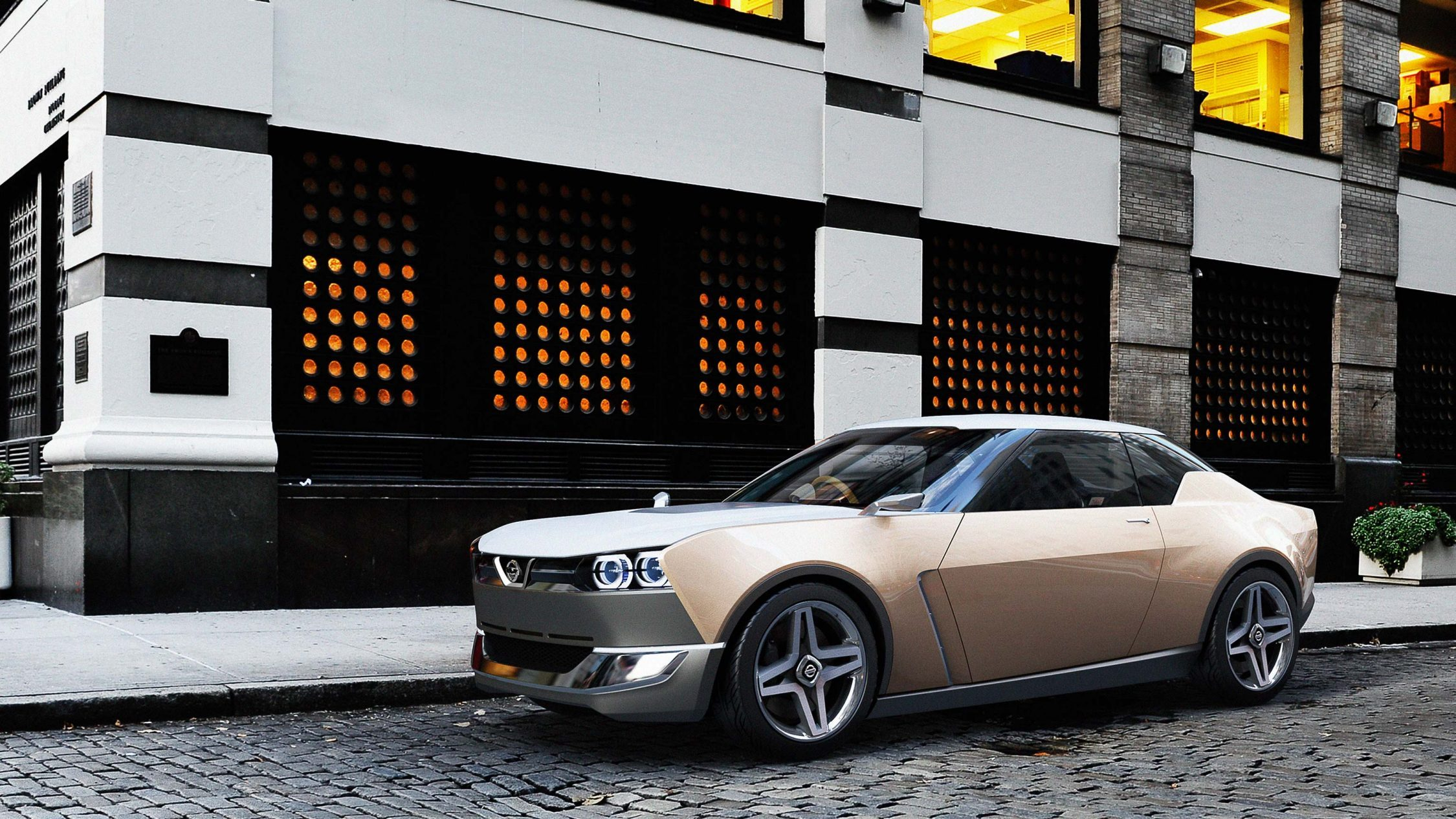 Nissan IDX Freeflow Concept. Gallery low 3/4 rear parked in city.