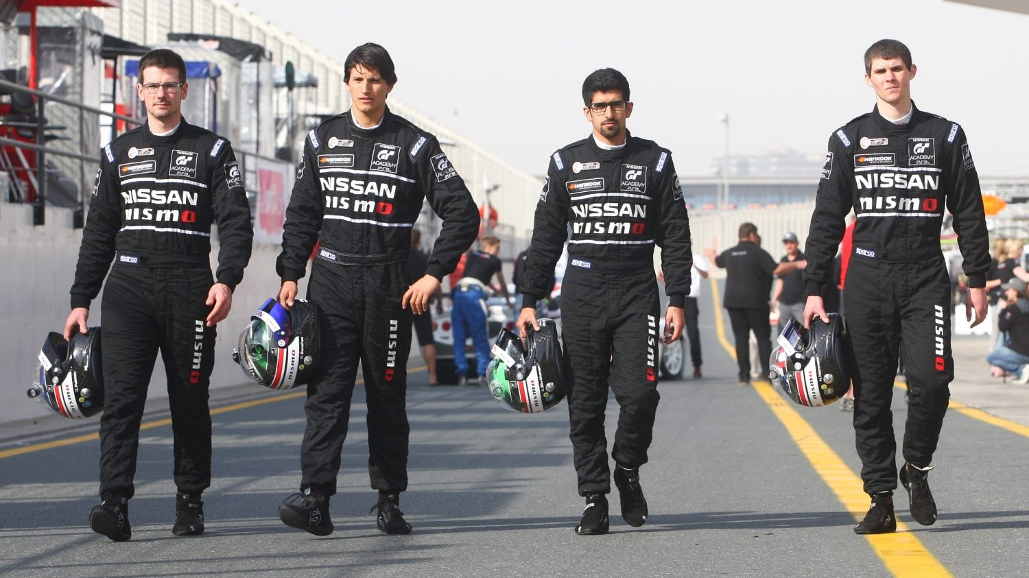 Nissan GT Academy Suited up drivers on the track.