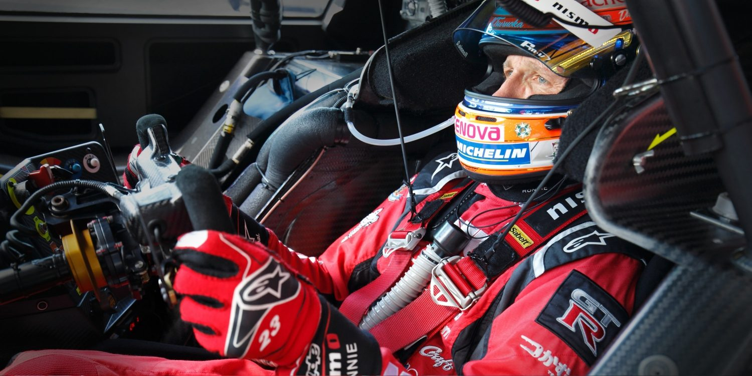 Racer in driver's cockpit of race car