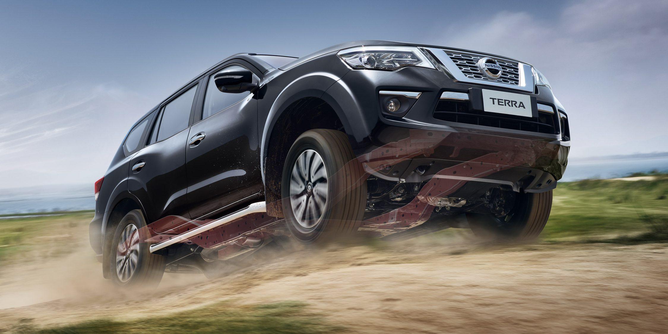 Nissan Terra driving up a rough dirt road
