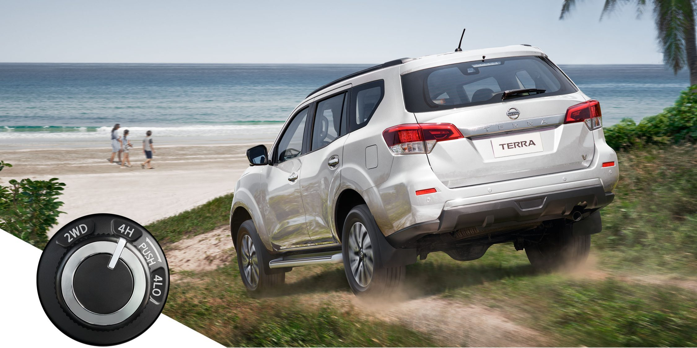 Nissan Terra driving on a dirt towards beach with 4x4 dial inset