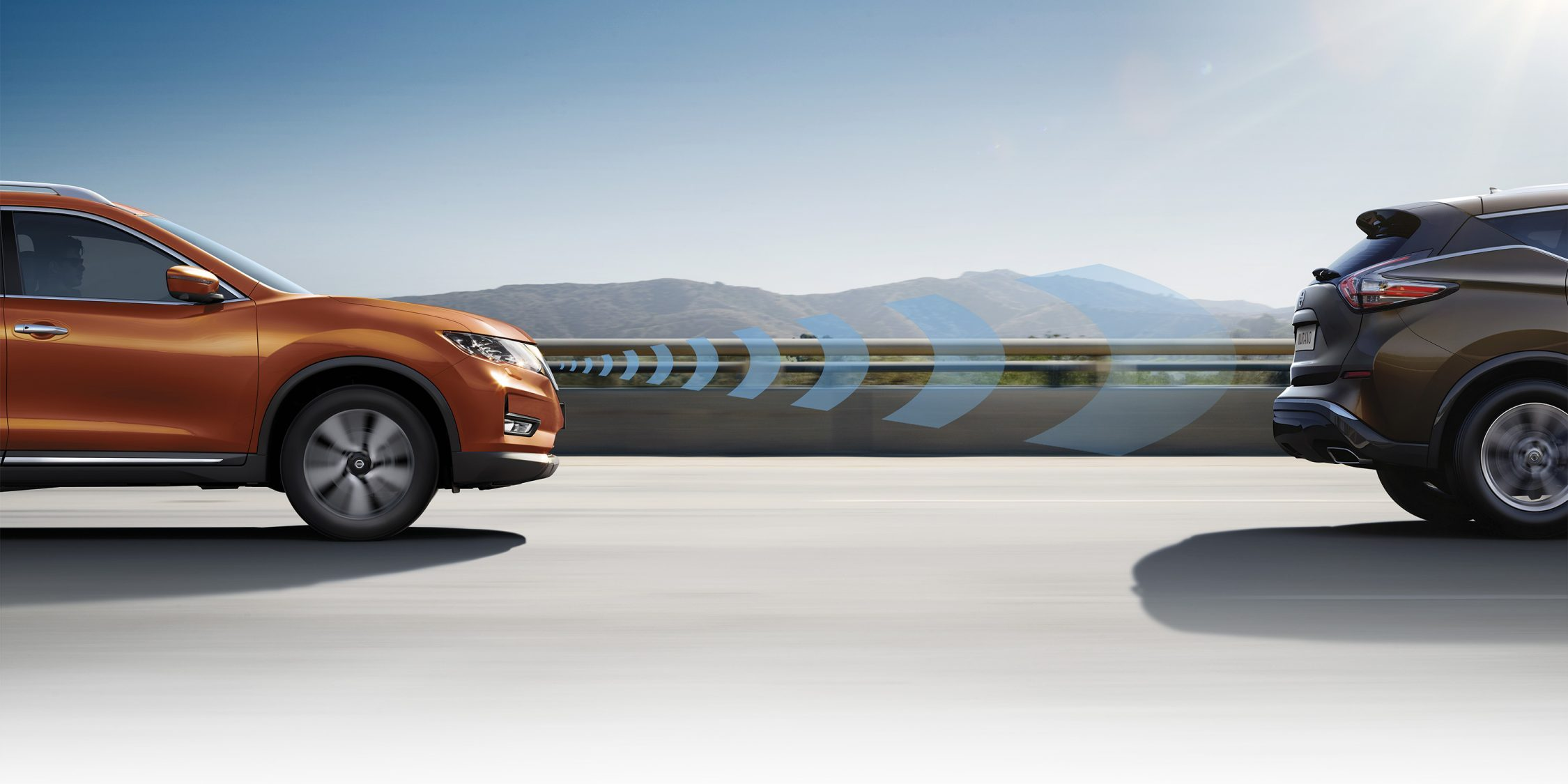 Nissan X-Trail profile driving shot with Intelligent Mobility shapes