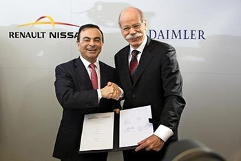 Carlos Ghosn (left) and Daimler Chairman Dieter  Zetsche celebrate the launch of their partnership.