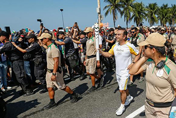 Carlos Ghosn carries the torch for the Rio de Janeiro  Olympic Games.