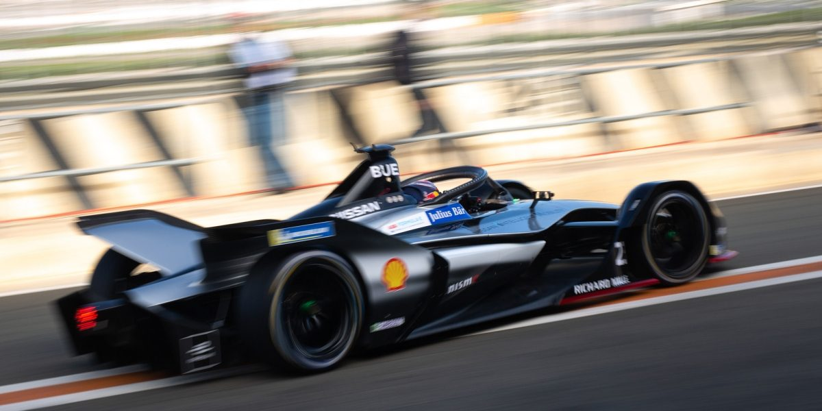Nissan Formula E Racer accelerates out of pit area