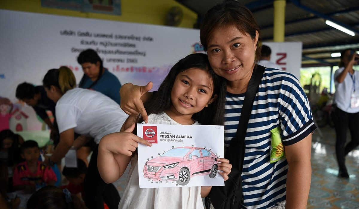 Children from the Sisa Chorakhe Yai community with Nissan in Thailand volunteers celebrate Children's Day at the community adjacent to Nissan's manufacturing facilities on Bangna-Trad Road, Samut Prakan province